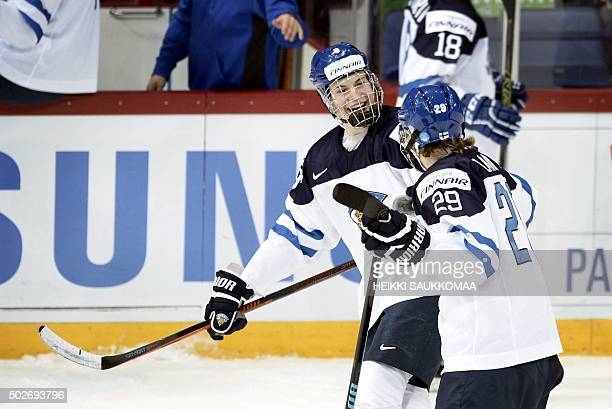 Finland's Jesse Puljujärvi and Patrik Laine celebrate the 12 goal by Laine during the 2016 IIHF World Junior Ice Hockey Championship match between...
