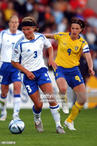 Finland's Jessica Julin wins the ball ahead of Sweden's Malin Andersson
