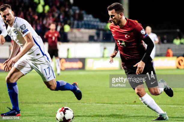Finland's Juha Pirilä and Turkey's Oguzhan Özyakup during the FIFA World Cup 2018 qualification football match between Finland and Turkey in Turku...