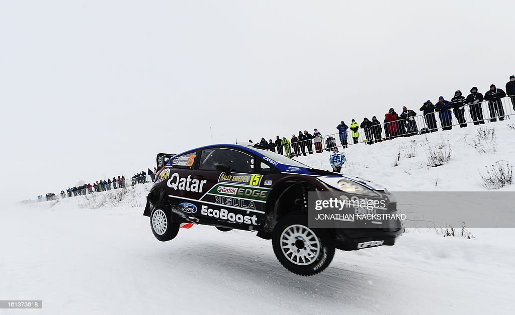 Finland's Juho Hanninen and his co-driver Tomi Tuominen steer their Ford Fiesta RS WRC during Kirkenaer stage, the 19th of Rally Sweden, second round of the FIA World Rally Championship on February 10, 2013 in Kirkenaer, Norway. AFP PHOTO/JONATHAN NACKSTRAND