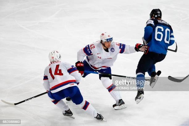 Finland's Julius Honka vies with Norway's Henrik Odegaard and Norway's Dennis Sveum during the IIHF Men's World Championship group B ice hockey match...
