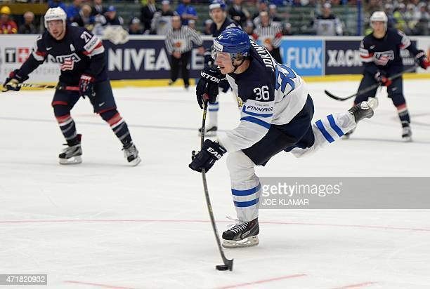 Finland's Jussi Jokinen shoots the puck during the group B preliminary round ice hockey match USA vs Finland of the IIHF International Ice Hockey...