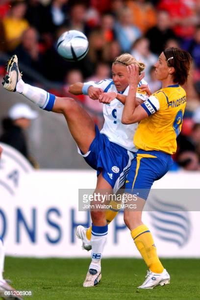Finland's Laura Kalmari wins the ball ahead of Sweden's Malin Andersson