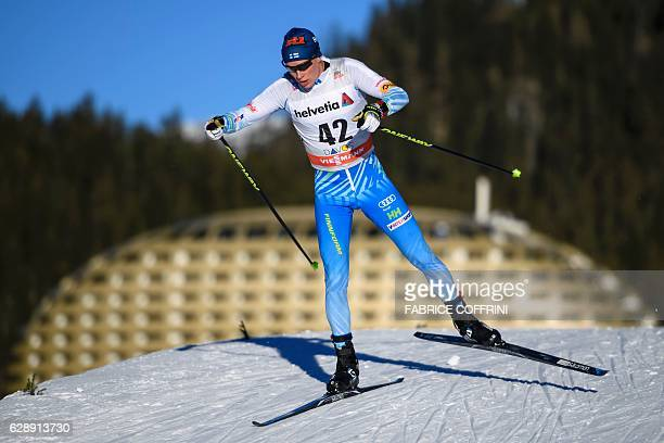 Finland's Matti Heikkinen competes to place third in the Men's 30km individual free race at the FIS Cross Country World Cup Nordic skiing event on...