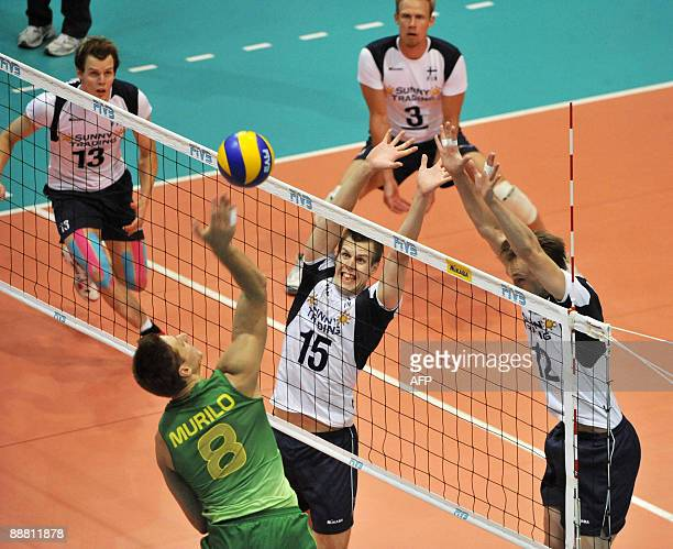 Finland's Matti Oivanen and Olli Kunnari try to block in front of Brazil's Murillo Endres while Mikko Oivanen and Mikko Esko follow in the background...