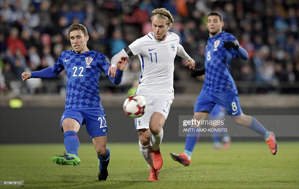 Finland's midfielder Rasmus Schueller (C) vies for the ball with Croatia's defender Josip Pivaric (L) and Croatia's midfielder Mateo Kovacic (R) during the 2018 World Cup qualifier football match of Finland vs Croatia in Tampere, Finland, on October 9, 2016. / AFP / LEHTIKUVA / Antti Aimo-Koivisto / Finland OUT