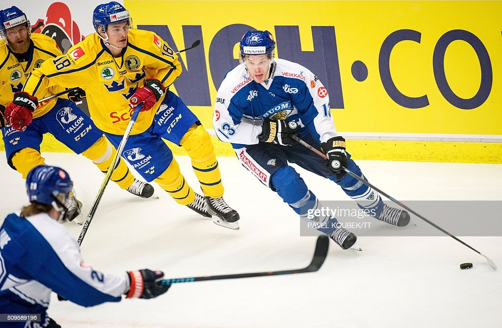 Finland's Mika Niemi vies with Sweden's Johan Sundstrom during the Euro Hockey Tour match between Sweden and Finland in Behrn Arena in Orebro on...