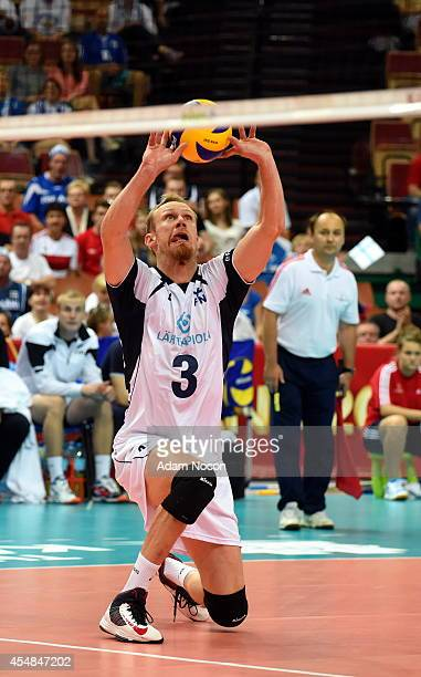 Finland's Mikko Esko passes the ball during the FIVB World Championships match between Tunisia and Finland on Septembert 7 2014 in Katowice Poland