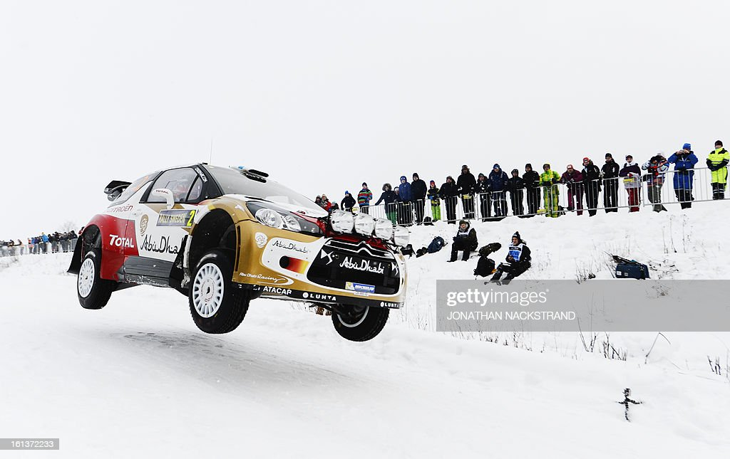 Finland's Mikko Hirvonen and his co-driver Jarmo Lehtinen steer their Citroen DS3 WRC during the 19th Rally Sweden, second round of the FIA World Rally Championship on February 10, 2013 in Kirkenaer, Norway.
