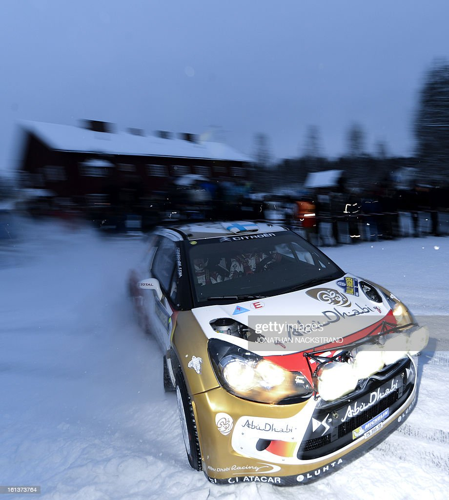 Finland's Mikko Hirvonen and his co-driver Jarmo Lehtinen steer their Citroen DS3 WRC during Mitandersfors stage, the 17th of Rally Sweden, second round of the FIA World Rally Championship on February 10, 2013 in Kirkenaer, Norway. AFP PHOTO/JONATHAN NACKSTRAND