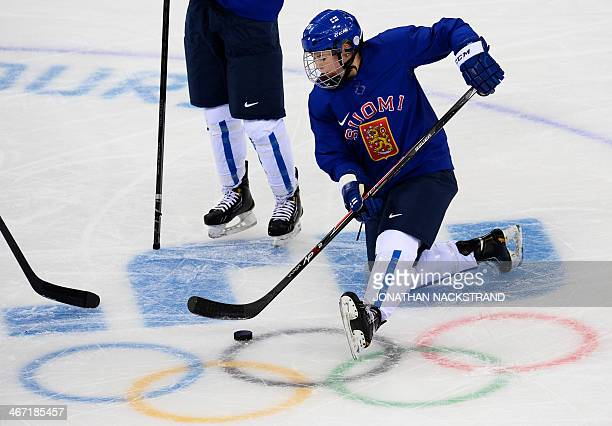 Finland's Minnamari Tuominen takes part in a training session of the Women's Finnish Ice Hockey at the Shayba Arena ahead of the Sochi Winter...
