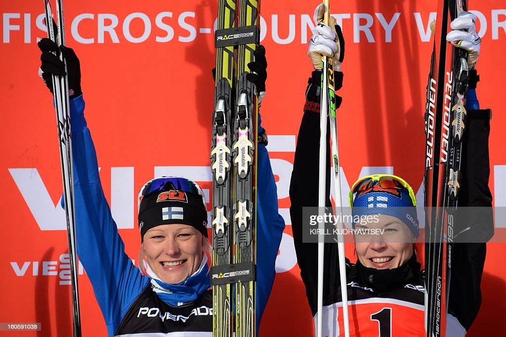 Finland's Mona-Lisa Malvalehto and Anne Kylloenen (R) react after 6 x 1,25 km Ladies' Classic Team Sprint of FIS Cross Country skiing World Cup at Laura Cross Country and Biathlon Center in Russian Black Sea resort of Sochi on February 3, 2013. Finland's Mona-Lisa Malvalehto and Anne Kylloenen took the first place ahead of Russia's Julia Ivanova and Natalia Matveeva and Canada's Perianne Jones and Daria Gaiazova. AFP PHOTO/KIRILL KUDRYAVTSEV