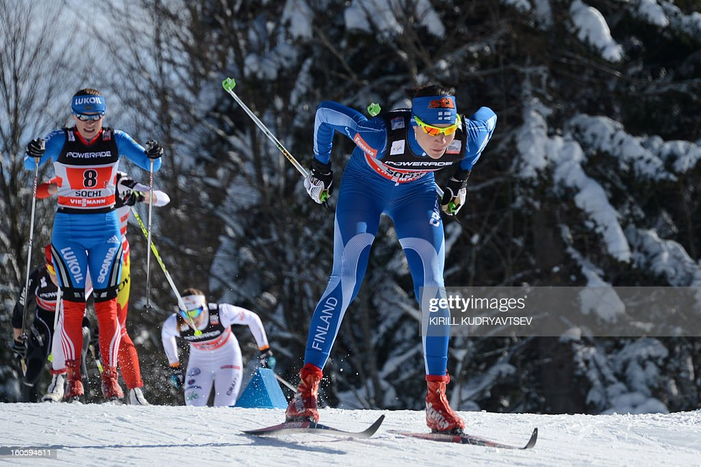Finland's Mona-Lisa Malvalehto (R) competes during 6 x 1,25 km Ladies' Classic Team Sprint of FIS Cross Country skiing World Cup at Laura Cross Country and Biathlon Center in Russian Black Sea resort of Sochi on February 3, 2013. Finland's Mona-Lisa Malvalehto and Anne Kylloenen took the first place ahead of Russia's Julia Ivanova and Natalia Matveeva and Canada's Perianne Jones and Daria Gaiazova.