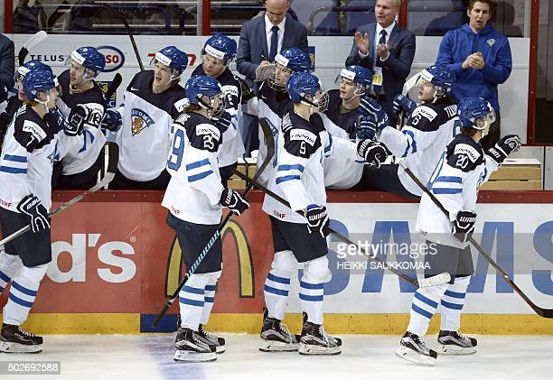 Finland's Niko Mikkola Patrik Laine Jess Puljujärvi and Sebastian Aho celebrate Finland's opening 01 goal by Aho during the 2016 IIHF World Junior...