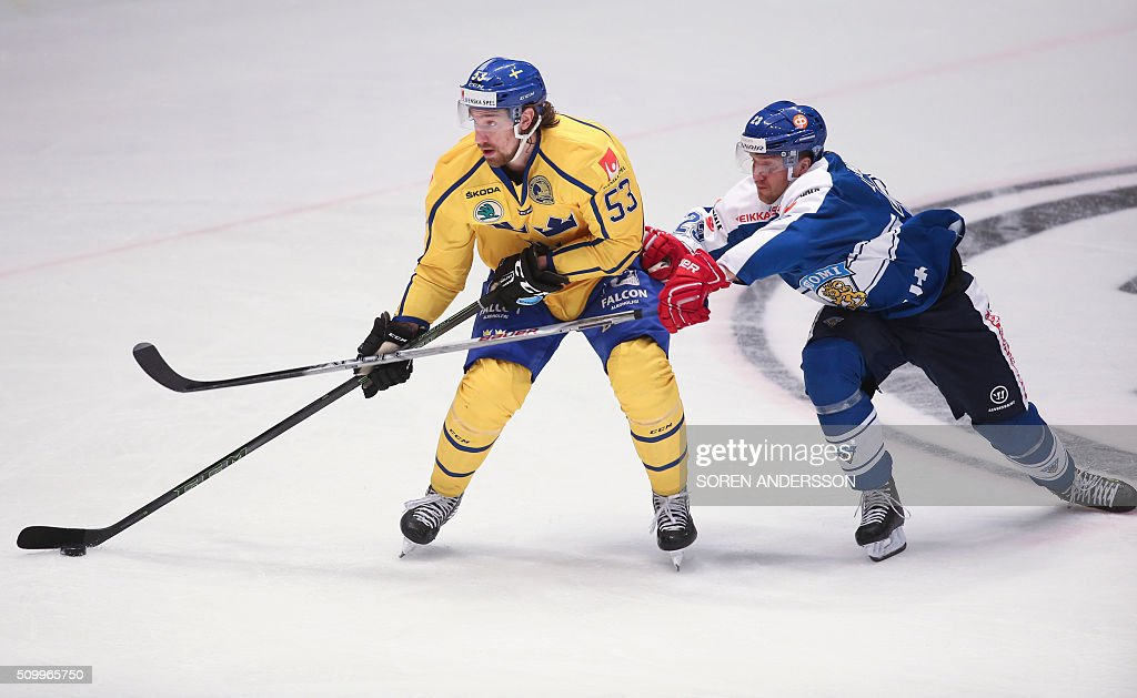 Finland's Patrik Laine and Sweden's Andreas Thuresson vie on February 13 2016 during the Euro Hockey Tour match between Sweden and Finland in...