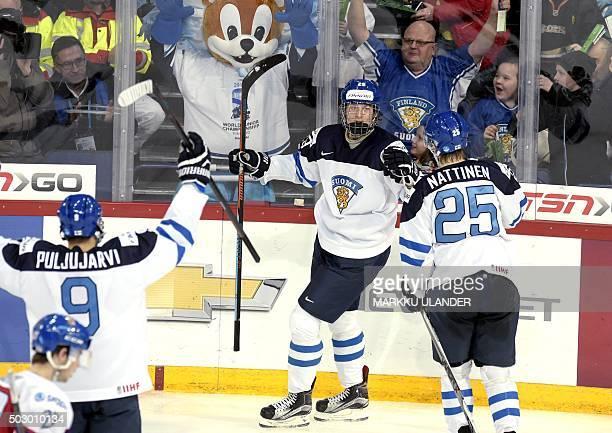 Finland's Patrik Laine celebrates his game winning goal 54 with Jesse Puljujarvi and Julius Nättinen during the 2016 IIHF World Junior U20 Ice Hockey...