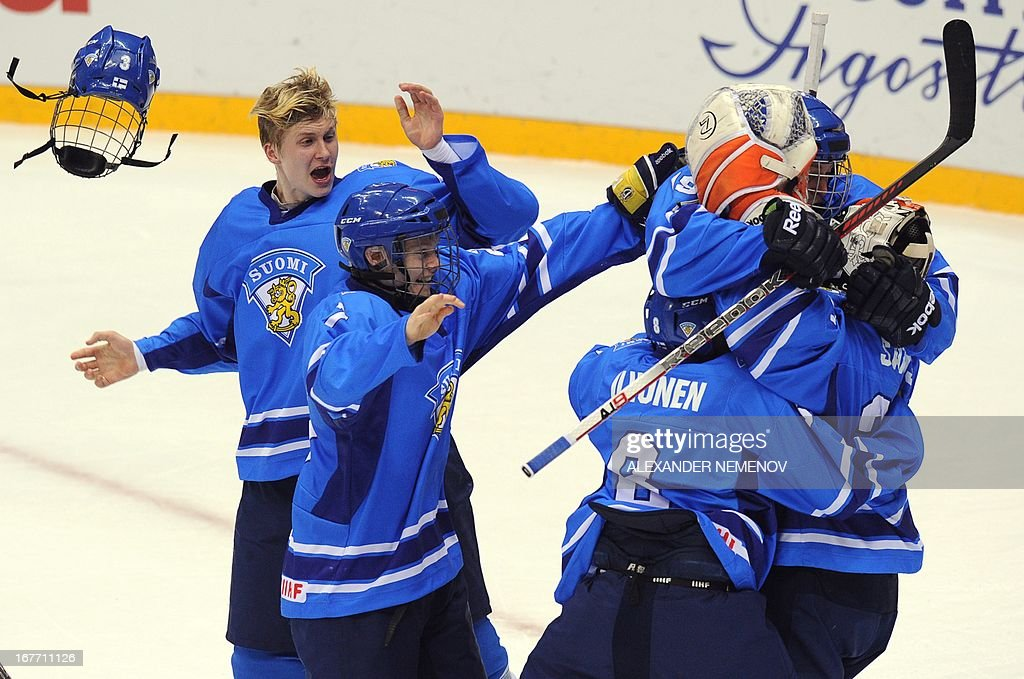 Finland's players celebrate after they defeated Russia during the IIHF U18 International Ice Hockey World Championship bronze medal match in Sochi on April 28, 2013. AFP PHOTO / ALEXANDER NEMENOV