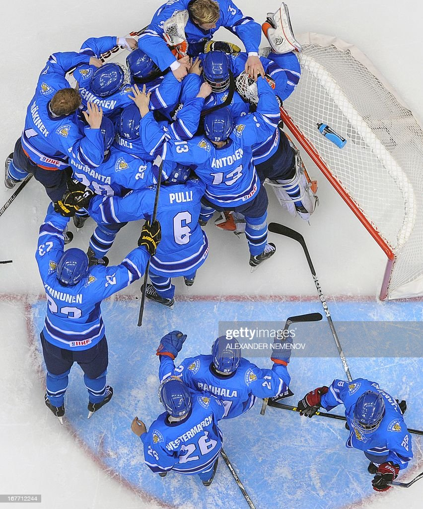 Finland's players celebrate after they defeated Russia in a IIHF U18 International Ice Hockey World Championship bronze medal match in Sochi on April 28, 2013.