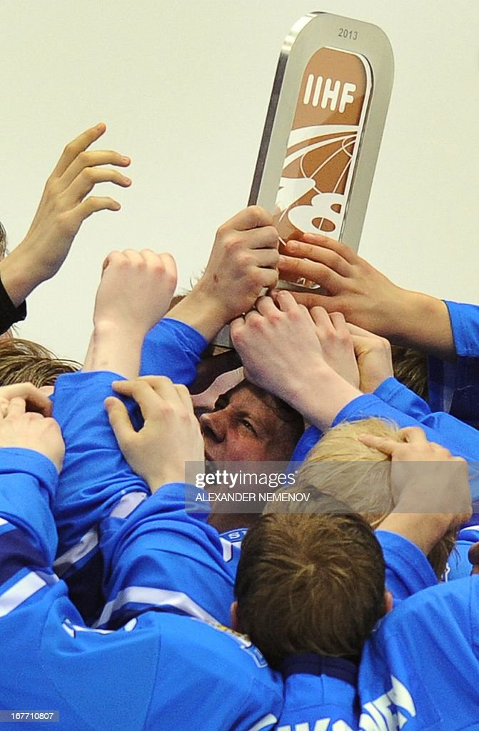 Finland's players celebrate with their trophy after winning 2-1 the IIHF U18 International Ice Hockey World Championship bronze medal match against Russia on April 28, 2013 in Sochi.
