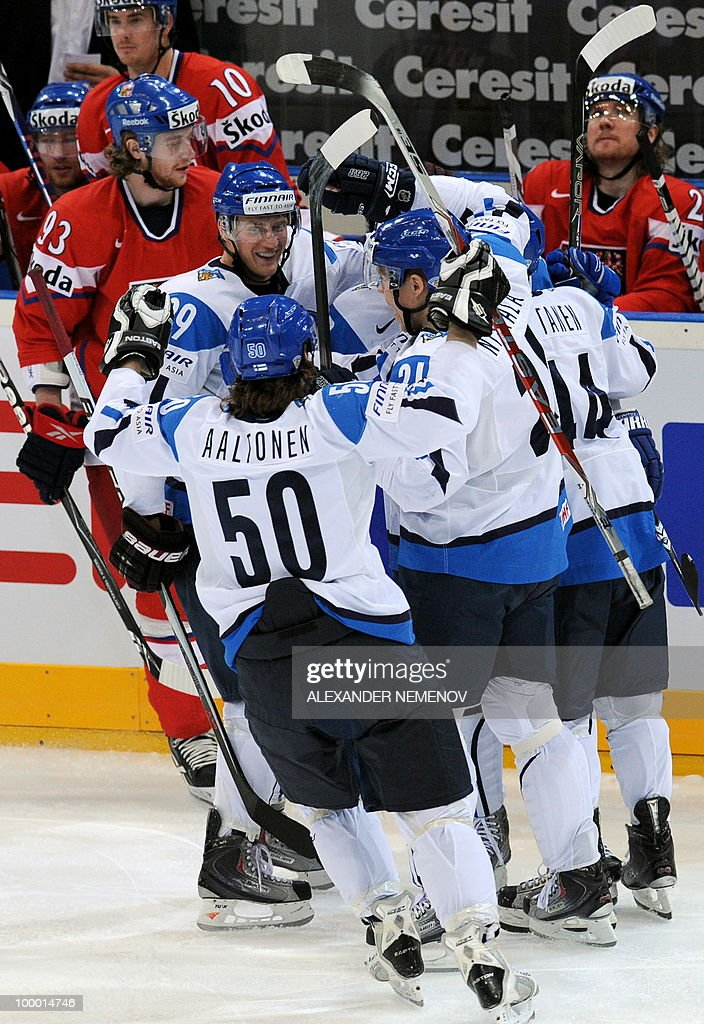 Finland's players celebrates scoring during the IIHF Ice Hockey World Championship quarter-final match Finland vs Czech Republic in the western German city of Cologne on May 20, 2010. The 2010 IIHF Ice Hockey World Championships are taking place in Germany from May 7 to 23, 2010.