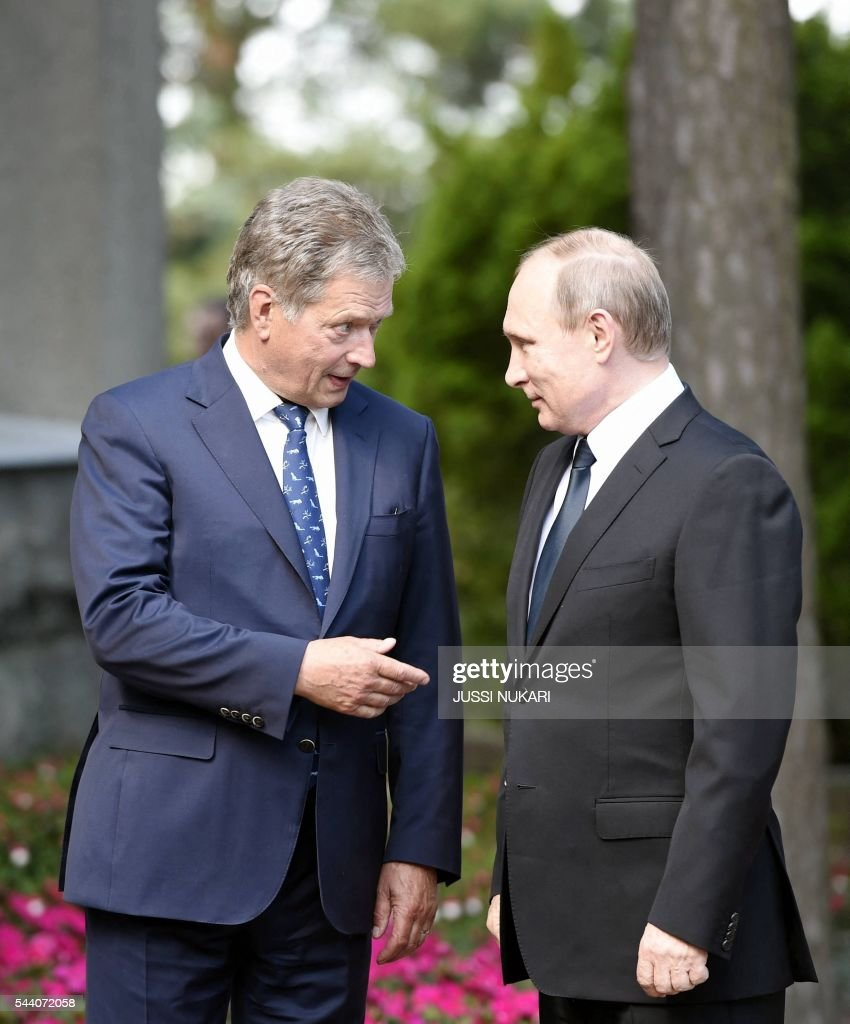Finland's President Sauli Niinistö (L) welcomes Russia's President Vladimir Putin at Kultaranta summer residence in Naantali, Finland, on July 1, 2016. President Putin is in Finland on a working visit to discuss both bilateral issues and topical international issues. / AFP / Lehtikuva / Jussi Nukari / Finland OUT