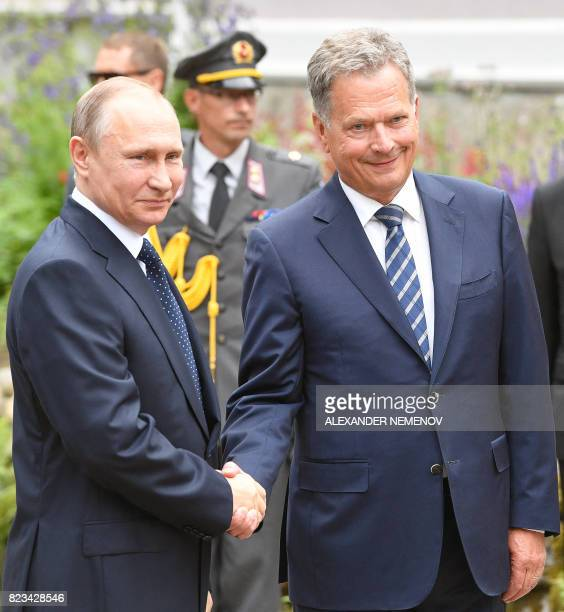 Finland's President Sauli Niinisto shakes hands with Russian President Vladimir Putin during their meeting in Punkaharju hotel in Savonlinna on July...