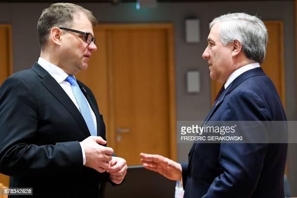 Finland's Prime Minister Juha Sipila and European Parliament President Antonio Tajani speak during a meeting of an EU Eastern Partnership summit with...