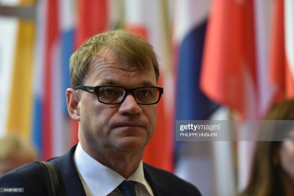 Finland's Prime minister Juha Sipila arrives for the second day of an EU - Summit at the EU headquarters in Brussels on June 29, 2016. European Union leaders will on June 29, 2016 assess the damage from Britain's decision to leave the bloc and try to prevent further disintegration, as they meet for the first time without a British representative. / AFP / PHILIPPE