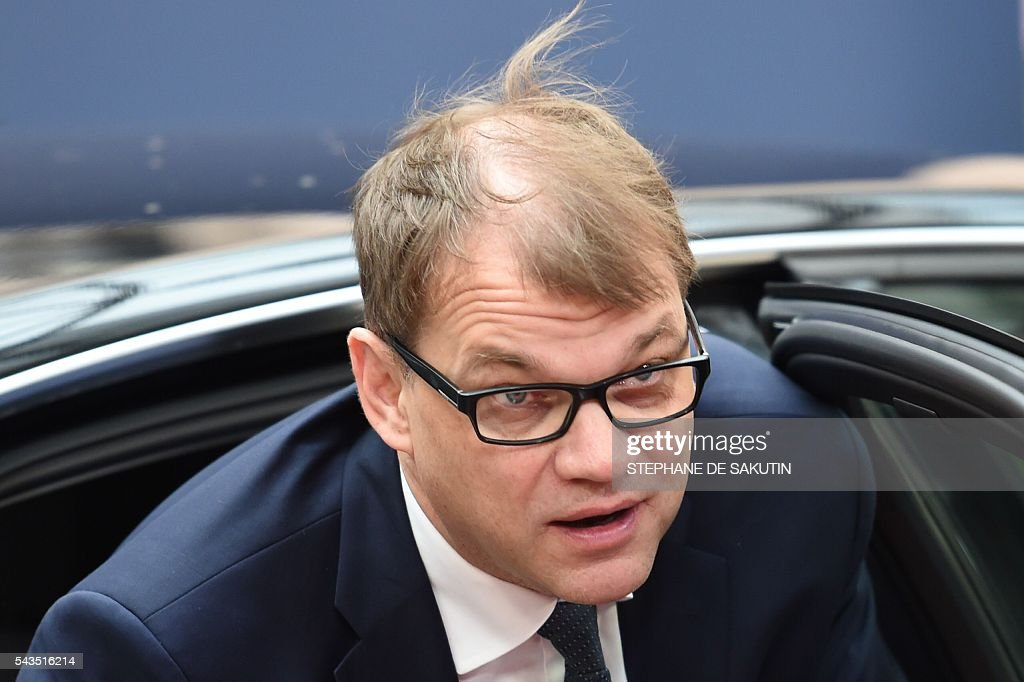 Finland's Prime minister Juha Sipila arrives for the second day of an EU - Summit at the EU headquarters in Brussels on June 29, 2016. European Union leaders will on June 29, 2016 assess the damage from Britain's decision to leave the bloc and try to prevent further disintegration, as they meet for the first time without a British representative. / AFP / STEPHANE