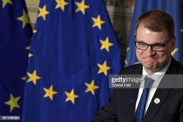 Finland's Prime Minister Juha Sipila signs the new Rome declaration with leaders of 27 European Union countries special during a summit of EU leaders...