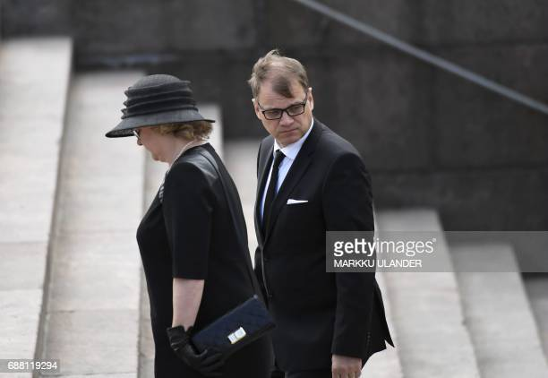 Finland's Prime Minister Juha Sipilae and his wife MinnaMaaria arrive at the Helsinki Cathedral for the state funeral ceremony of Finland's former...