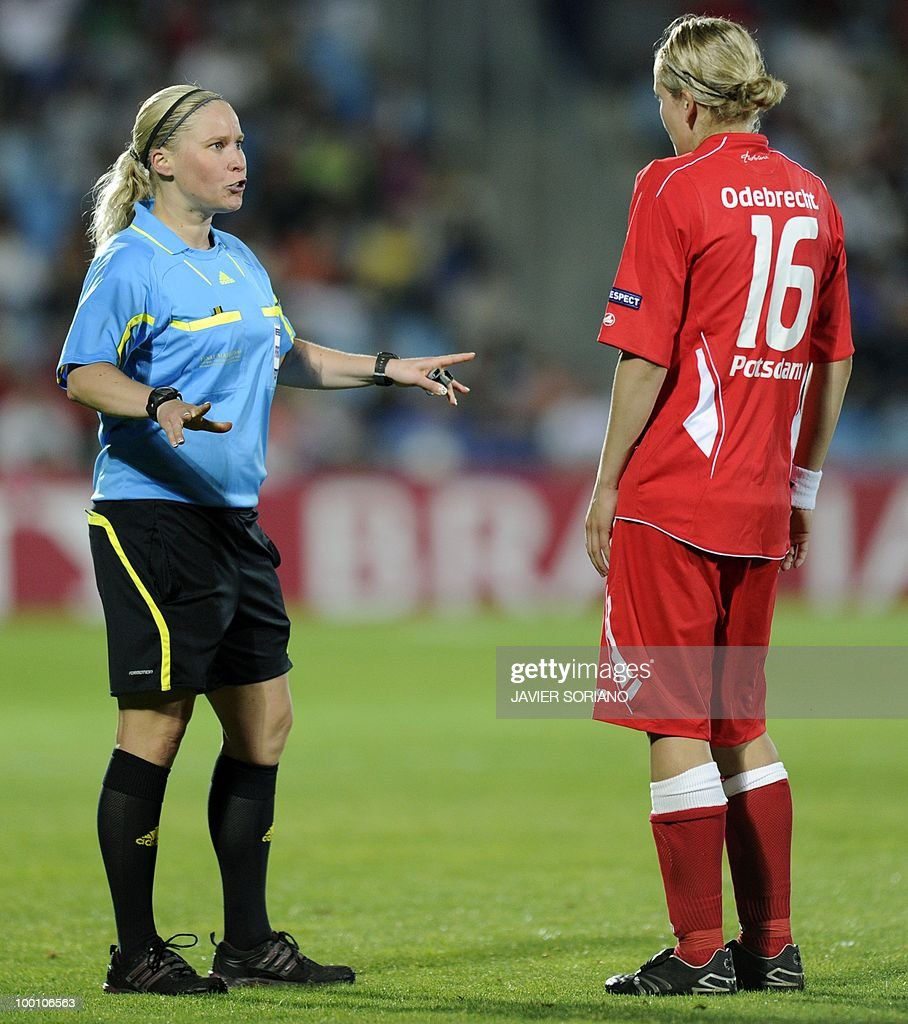 Finland's referee Kirsi Heikkinen (L) gestures in front of FFC Turbine Potsdam's midfielder Viola Odebrecht (R) during their UEFA women's Champions League final football match between Olympique Lyonnais and FFC Turbine Potsdam at the Coliseum Alfonso Perez stadium in Getafe on May 20, 2010. near Madrid.