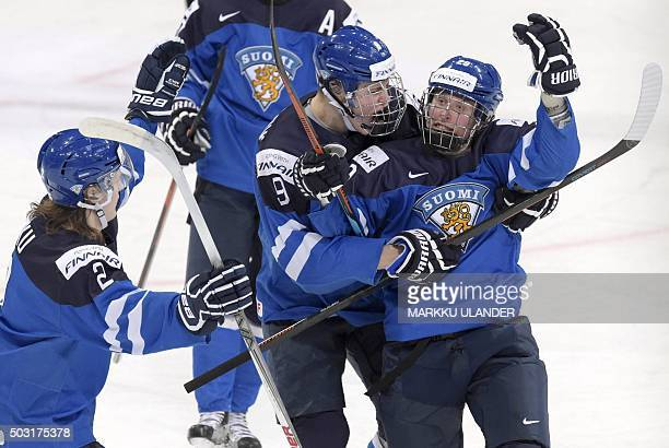 Finland's Sami Niku Patrik Laine and Jesse Puljujärvi celebrate the 12 goal during the 2016 IIHF World Junior Ice Hockey Championship quarterfinal...