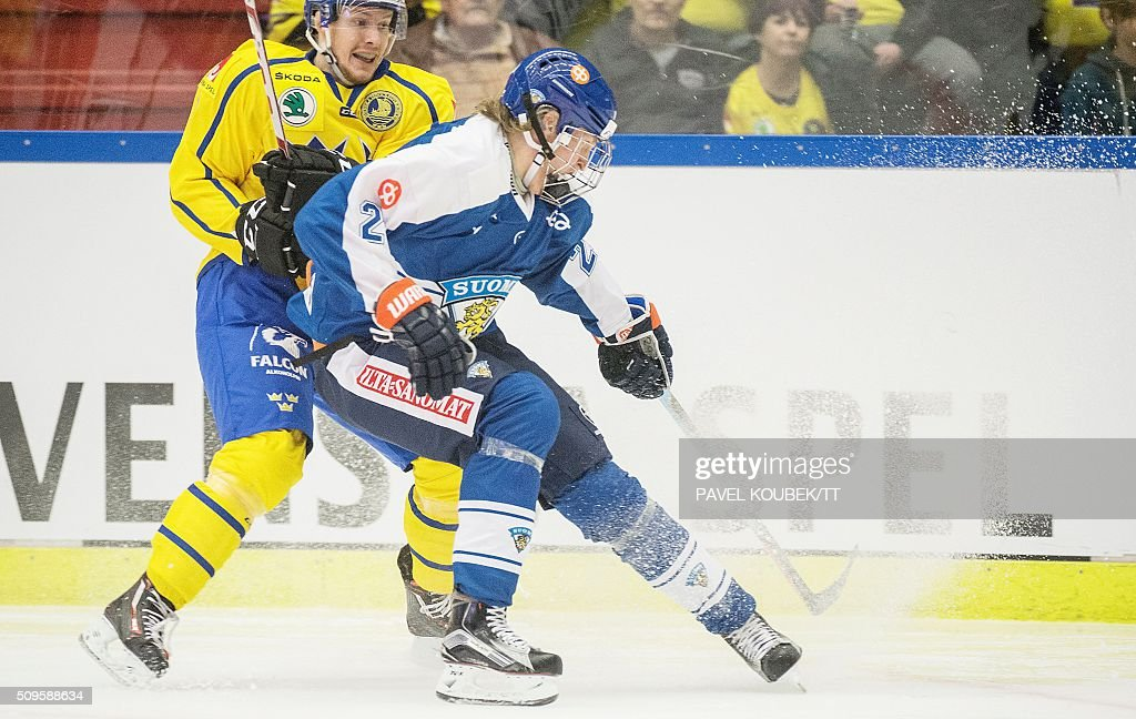 Finland's Sebastian Aho battles with a Swedish player Euro Hockey Tour match between Sweden and Finland in Behrn Arena in Orebro on February 11 2016...