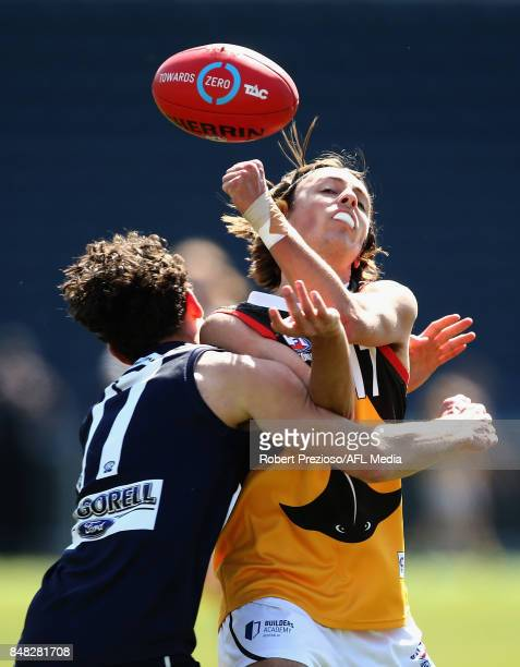 Finlay Bayne of Dandenong Stingrays handballs during the TAC Cup Preliminary Final match between Geelong and Dandenong at Simonds Stadium on...