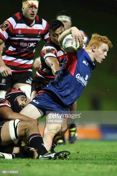 Finlay Christie of Tasman is tackled during the round nine Mitre 10 Cup match between Counties Manukau and Tasman at ECOLight Stadium on October 14...