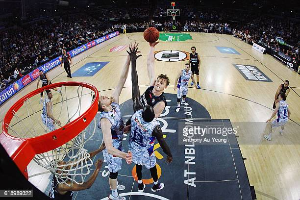Finn Delany of New Zealand puts up a shot against Majok Deng and Matt Hodgson of Adelaide during the round four NBL match between the New Zealand...