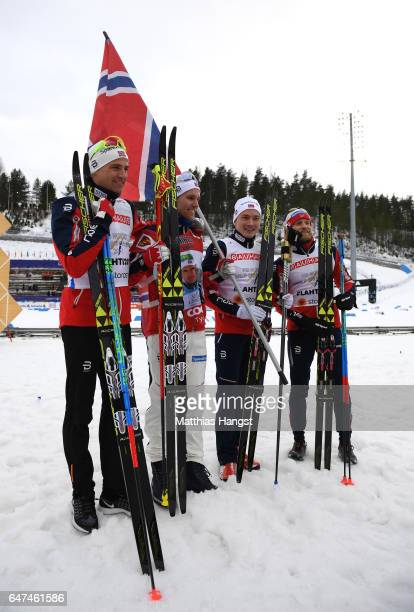 Finn Haagen Krogh Didrik Toenseth Niklas Dyrhaug and Martin Johnsrud Sundby of Norway celebrate winning the gold medal after the flower ceremony for...