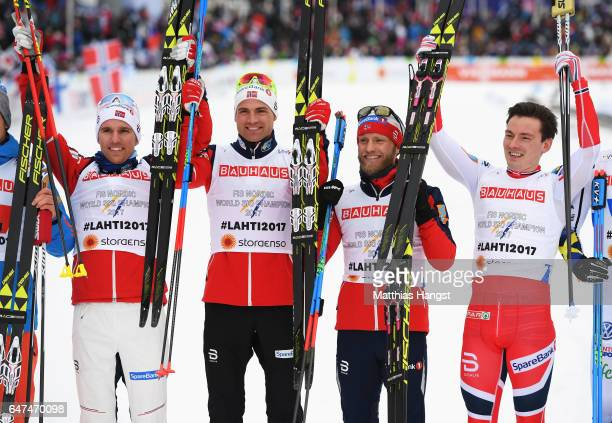 Finn Haagen Krogh Didrik Toenseth Niklas Dyrhaug and Martin Johnsrud Sundby of Norway celebrate winning the gold medal for the Men's 4x10km Cross...