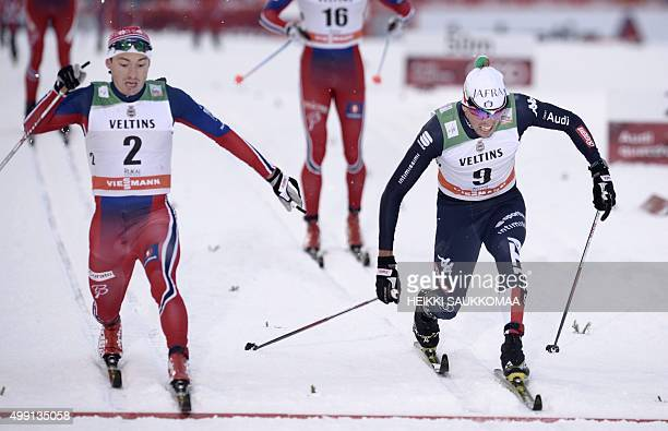 Finn Haagen Krogh of Norway crosses the finishline ahead of Francesco De Fabiani of Italy to place third in the men's classic style Cross Country...