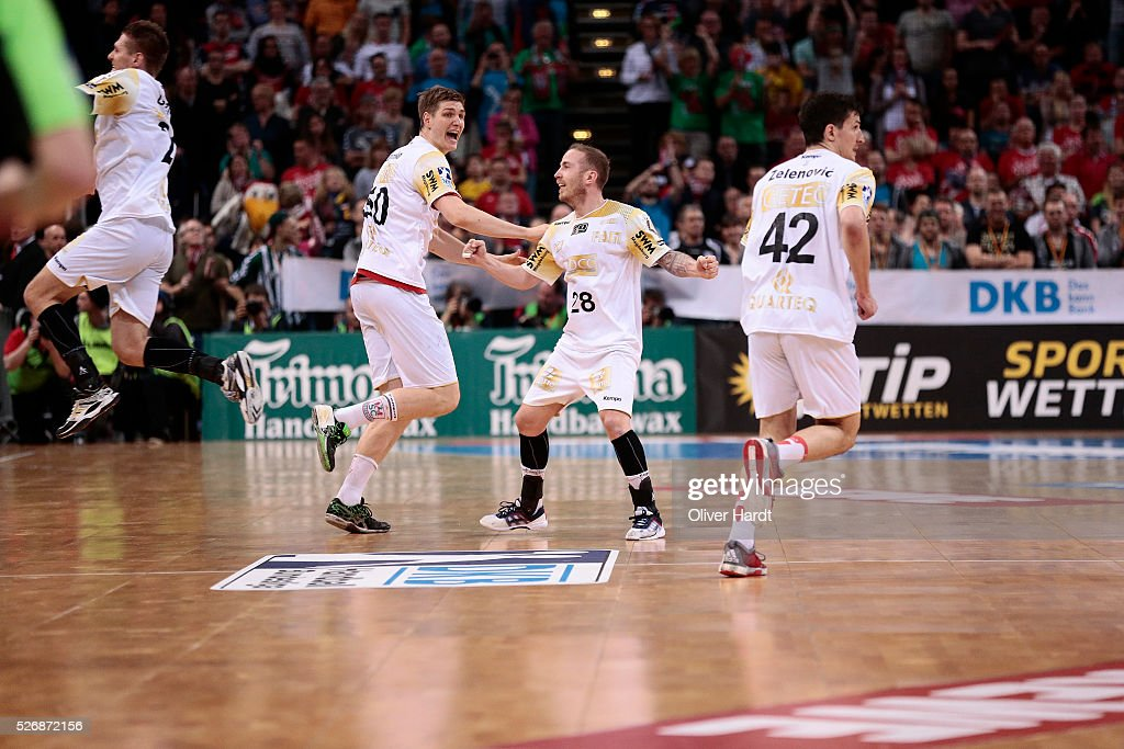 Finn Lemke and Robert Weber (L-R) of Magdeburg celebrate after winning the DKB REWE Final Four Finale 2016 between SG Flensburg Handewitt and SC Magdeburg at Barclaycard Arena on May 1, 2016 in Hamburg, Germany.
