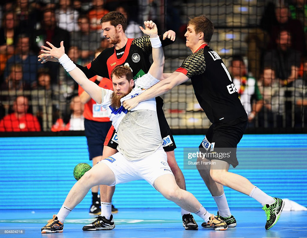 Finn Lemke of Germany challenges Kari Kristjan Kristjansson of Iceland during the international handball friendley match between Germany and Iceland at the TUI arena on January 10, 2016 in Hanover, Germany.