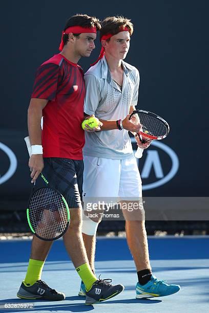 Finn Reynolds of New Zealand and Duarte Vale of Portugal compete in their Junior Doubles Final match against Yu Hsiou Hsu of Taipei and Lingxi Zhao...