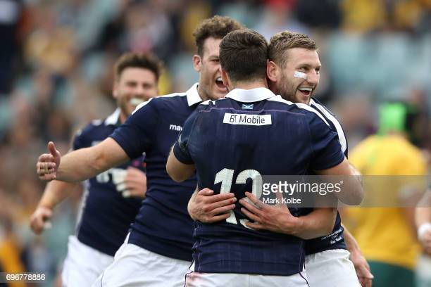 Finn Russell of Scotland celebrates with his team mate Alex Dunbar of Scotland after scoring a try during the International Test match between the...