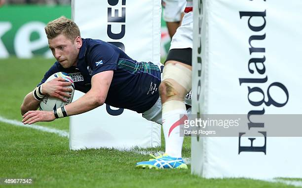 Finn Russell of Scotland dives over for a try during the 2015 Rugby World Cup Pool B match between Scotland and Japan at Kingsholm Stadium on...