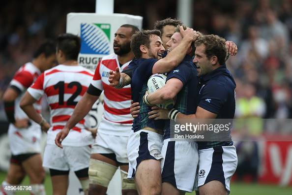 Finn Russell of Scotland is congratulated by team mates after scoring his teams fifth try during the 2015 Rugby World Cup Pool B match between...