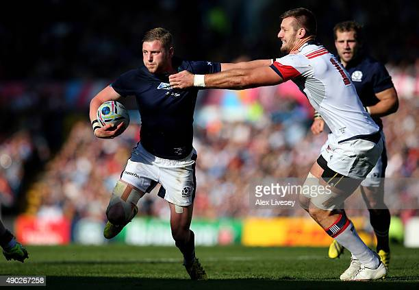 Finn Russell of Scotland is tackled by Cam Dolan of the United States during the 2015 Rugby World Cup Pool B match between Scotland and USA at Elland...
