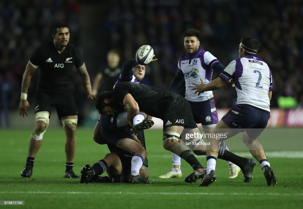 Finn Russell of Scotland is tackled by Samuel Whitelock of New Zealand during the International test match between Scotland and New Zealand at Murrayfield Stadium on November 18, 2017 in Edinburgh, Scotland.