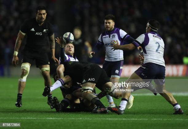 Finn Russell of Scotland is tackled by Samuel Whitelock of New Zealand during the International test match between Scotland and New Zealand at...