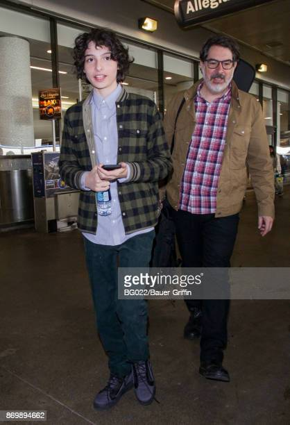 Finn Wolfhard and his father Eric are seen on November 03 2017 in Los Angeles California